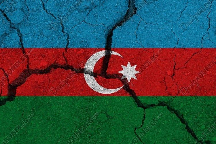 Azerbaijan flag on the cracked earth.
