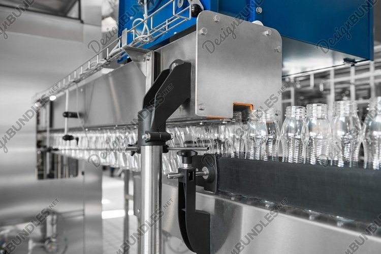 Empty plastic bottles on conveyor belt. Dairy plant example image 1