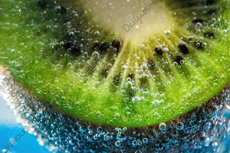 Ripe green kiwi. Fruit closeup example image 1