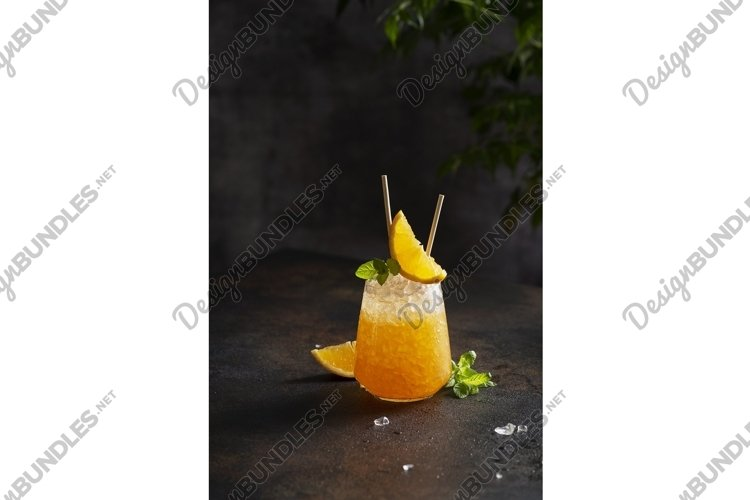 Fresh cold cocktail with orange, crushed ice and mint example image 1