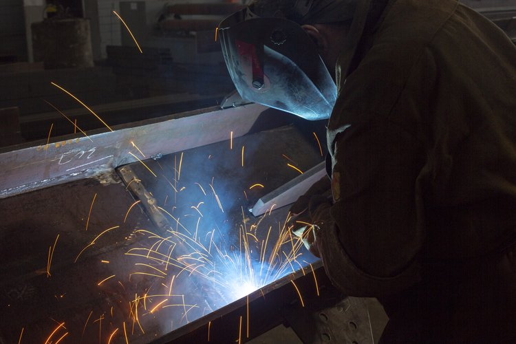 Industrial Worker at the factory welding closeup example image 1