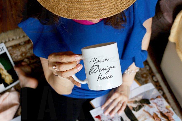 Mockup of Woman with ring holding mug, reading magazine 1022
