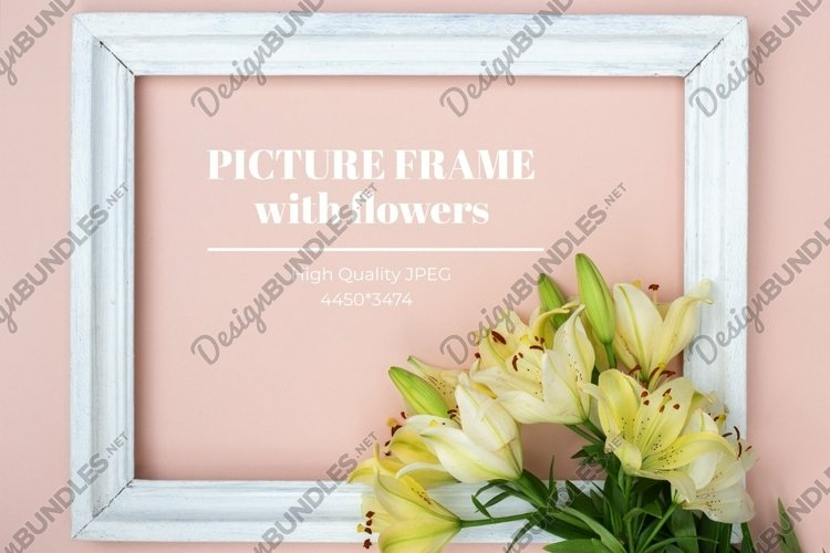 Yellow lilies and white frame on pastel background