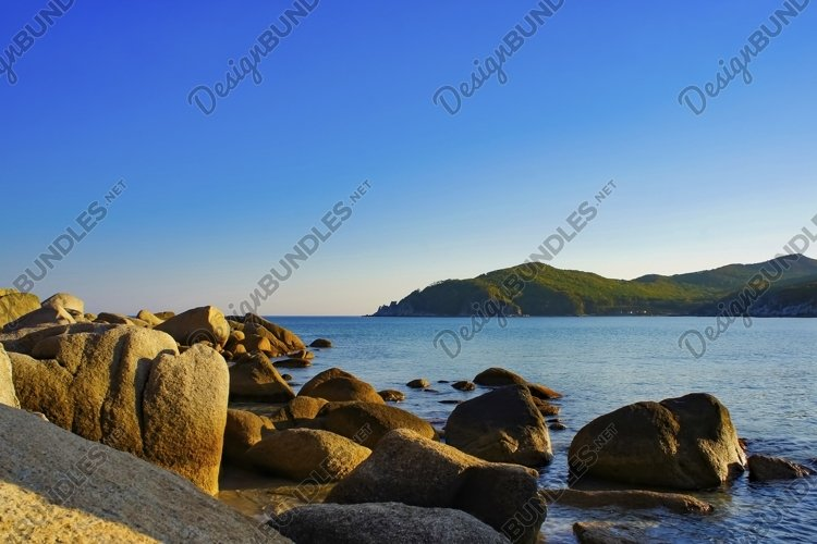 Seascape with picturesque rocks on the shore of the sea example image 1