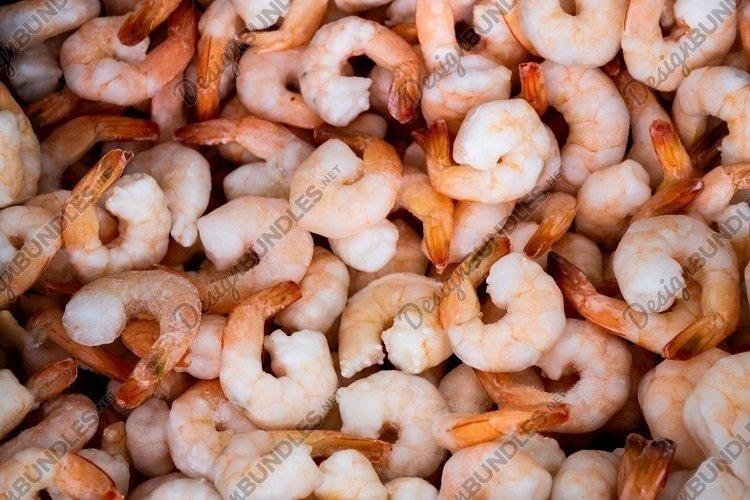 Frozen orange shrimps. Sea Food background example image 1