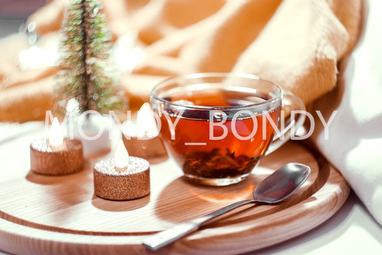 Christmas / New Year composition. A transparent cup of tea example image 1