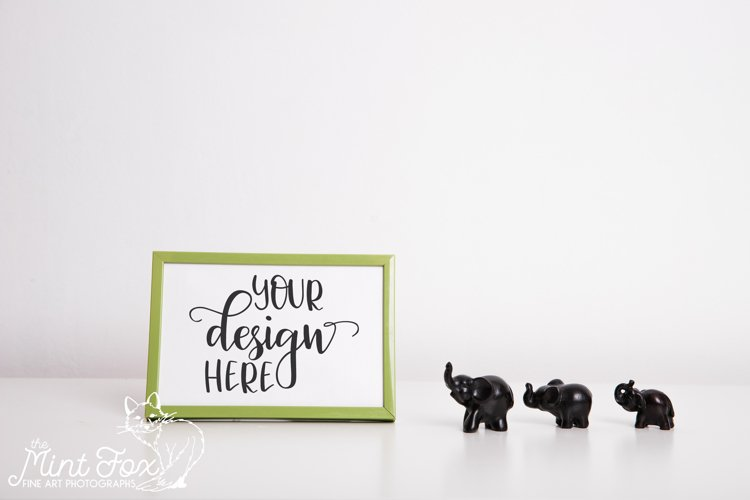 Small Picture Frame Mockup with Elephant Figurines