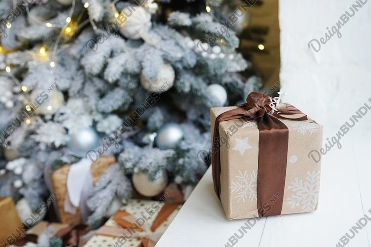 New Year gift on the window near Christmas tree , home decor example image 1