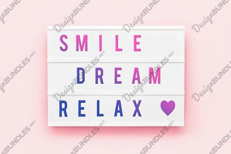 SMILE DREAM RELAX written in light box