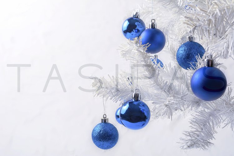 White Christmas tree with blue ornament copy space. example image 1