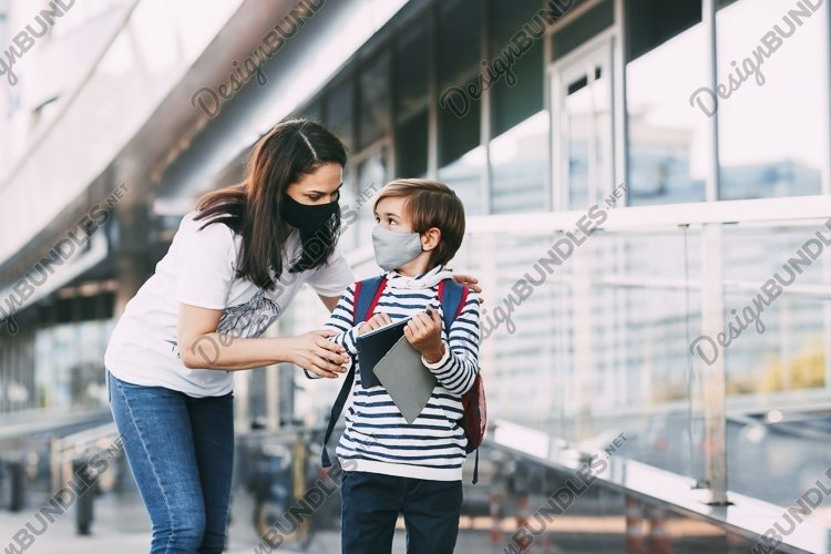 A young woman holds a tablet and shows her son the route example image 1