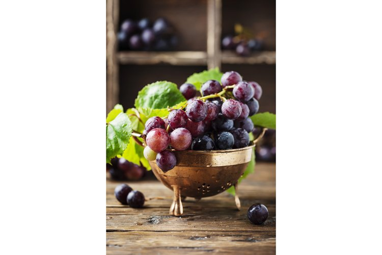 Red sweet grape on the wooden table, selective focus example image 1
