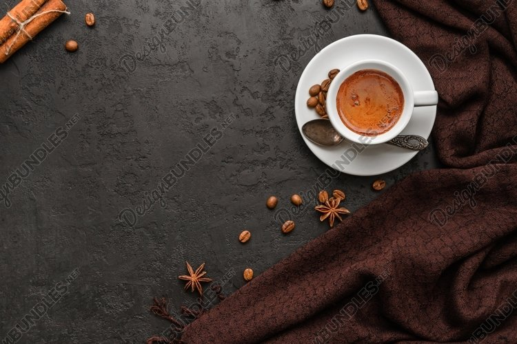 Cup of coffee, brown scarf, coffee beans on black background example image 1