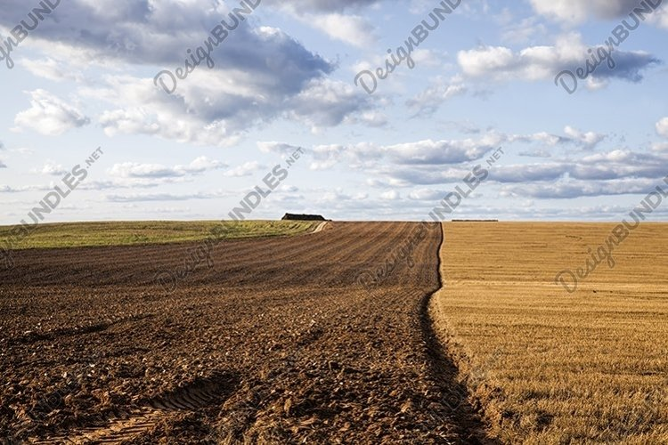 a half plowed agricultural field example image 1