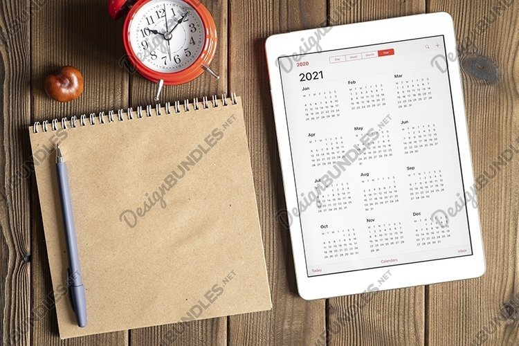tablet with calendar for 2021, clock, notebook, copy space example image 1