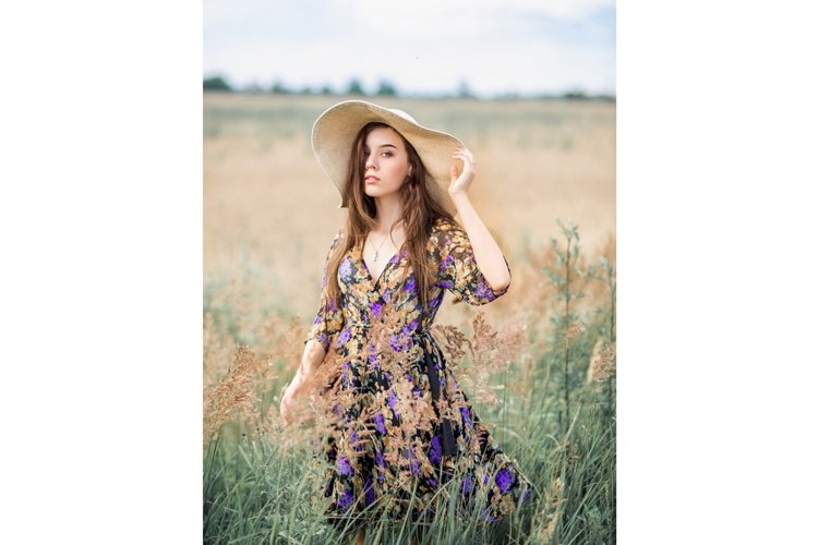 Girl in a hat in nature. Summer photo