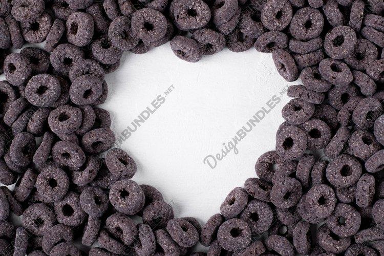 Black breakfast cereal loops framing copy space