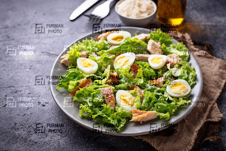 Caesar salad with eggs, chicken and parmesan example image 1