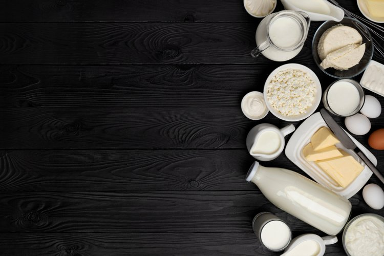 Dairy products on black wooden background, top view example image 1