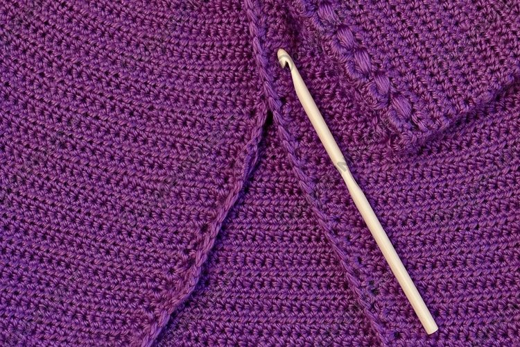 Baby purple cardigan, crocheted close-up and wooden hook example image 1