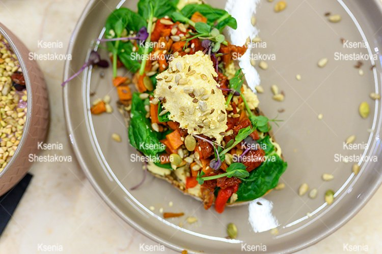 raw food. toast with homemade hummus and baked vegetables example image 1