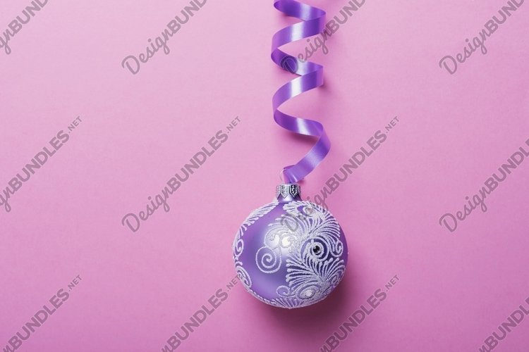 Christmas violet ball on the pink background example image 1