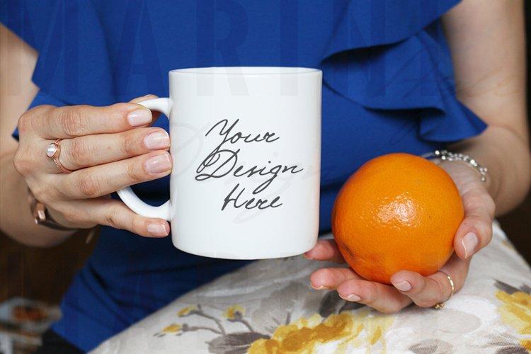 Mug Mockup of Woman with orange & ring holding mug, 1019