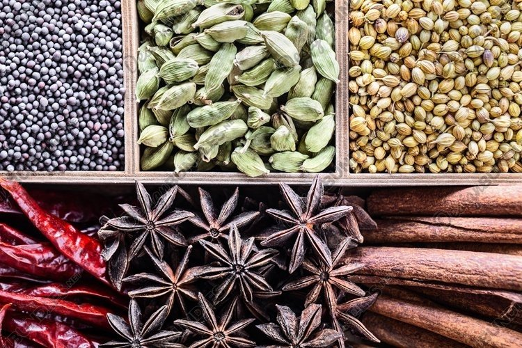 Different types of whole Indian spices in wooden box. example image 1