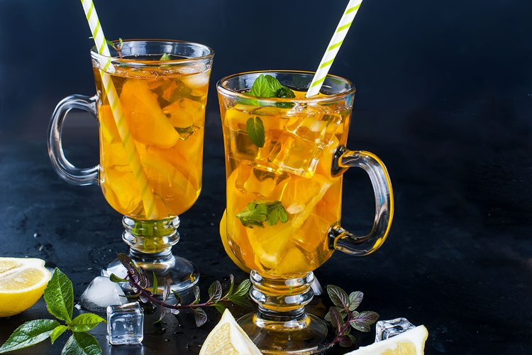 Cold tea with lemon, mint and ice example image 1