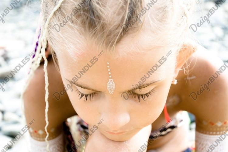 Portrait of a little girl with closed eyes. example image 1