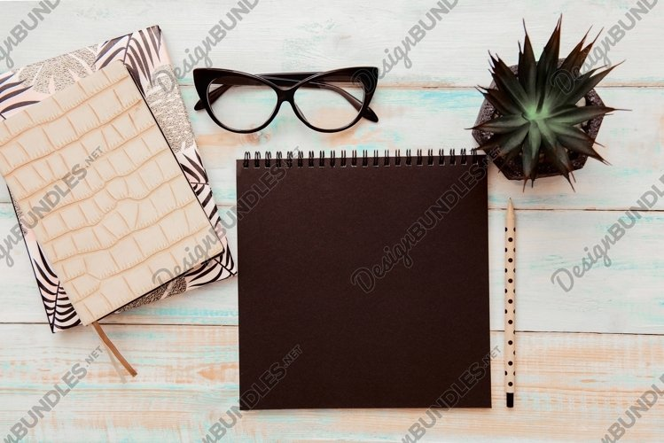 Business accessories on wooden background