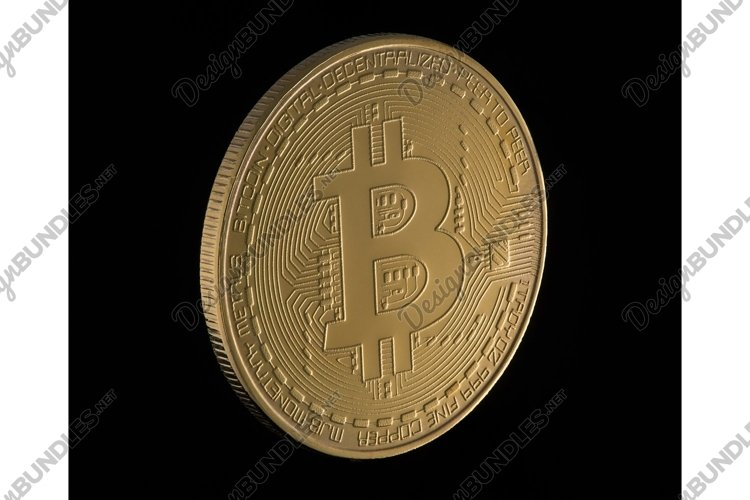 Gold bitcoin on a black background. Electronic money example image 1