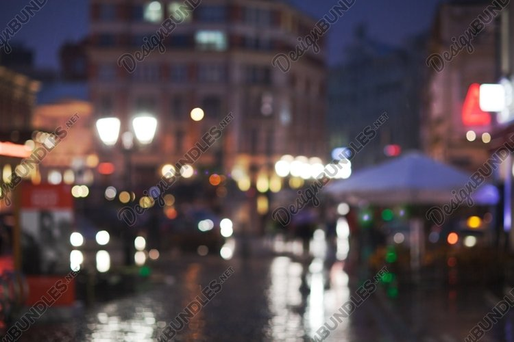Blurred cityscape on a rainy evening example image 1