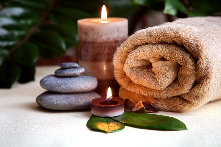 Burning candles and a towel. Stone therapy. Spa treatments. example image 1
