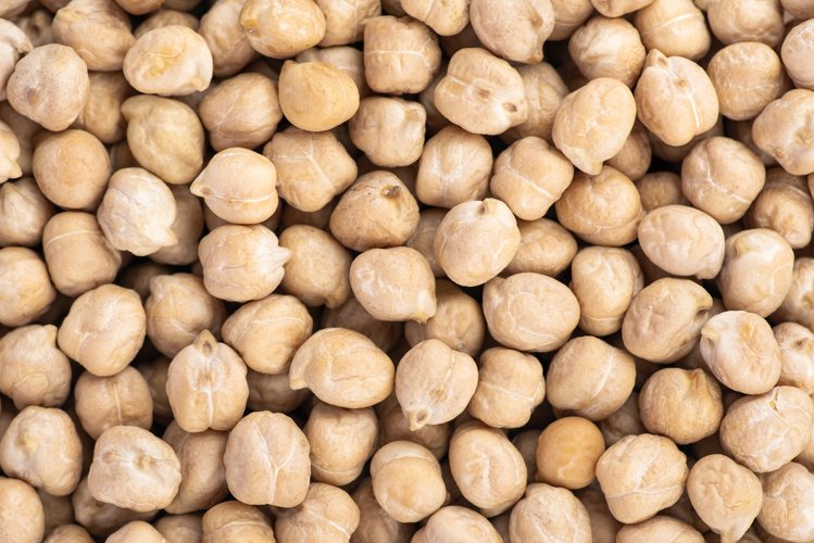 Chickpeas background close up. Healthy vegan food concept.
