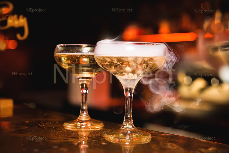 Alcohol drink with smoke in the night bar