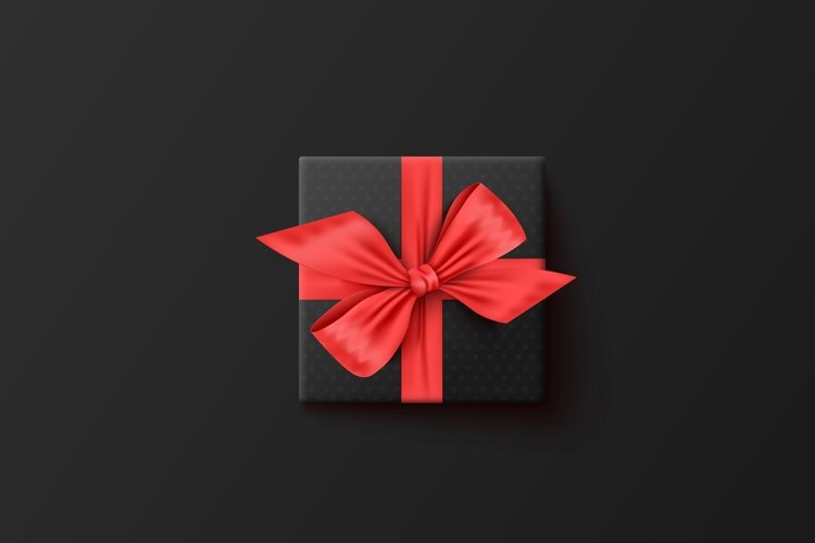 Black gift box with red ribbon, top view