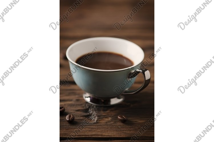 Cup of italian strong coffee espresso on the vintage table example image 1