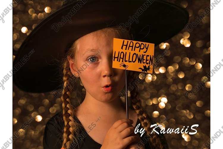 Child in a hat with Happy Halloween greeting card says Boo