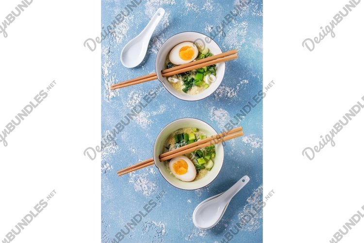 Asian soup with eggs, onion and spinach example image 1
