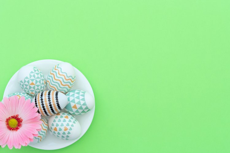 Decorated Easter eggs lie on the white plate example image 1
