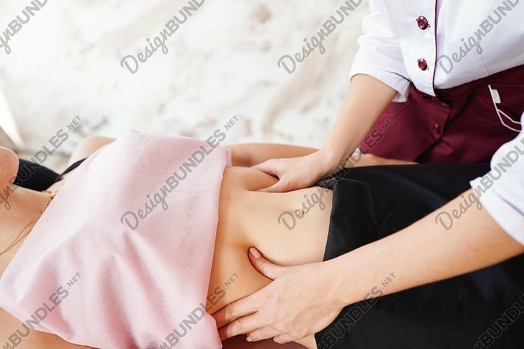 Belly massage close up. Stomach of young woman example image 1