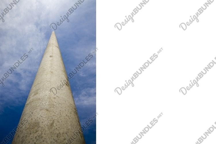 long concrete electric pole against the blue sky, close-up example image 1