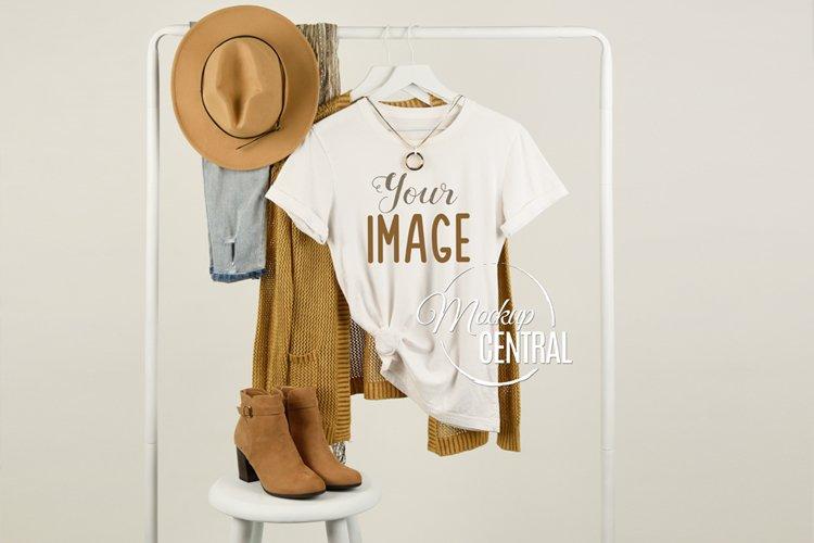 Womans White T-Shirt Fashion Mockup on Clothing Rack