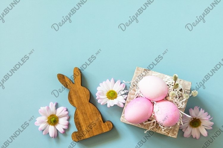 Spring flowers and Easter eggs. Minimal Easter concept.