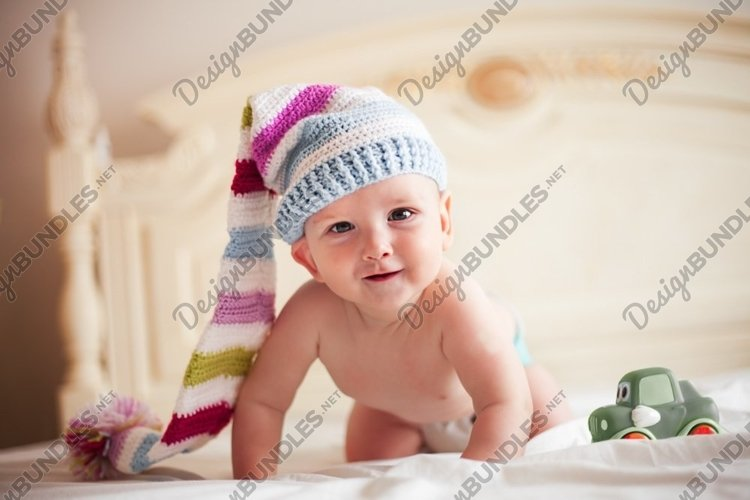 Five-month baby in crochet hat