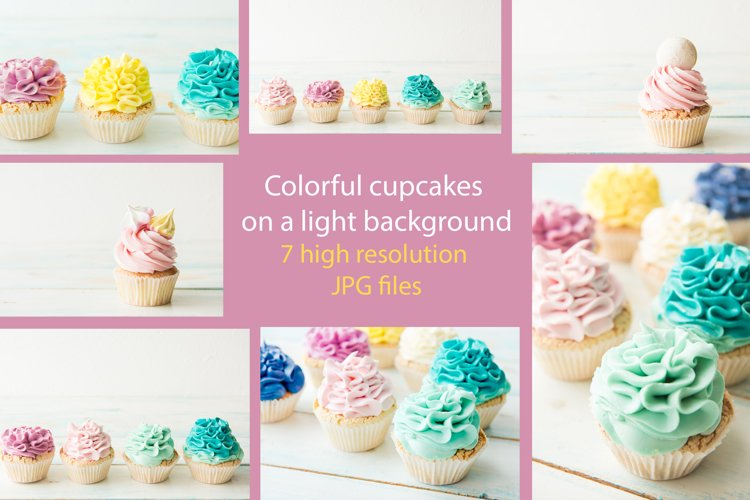 Colorful cupcakes on a light background