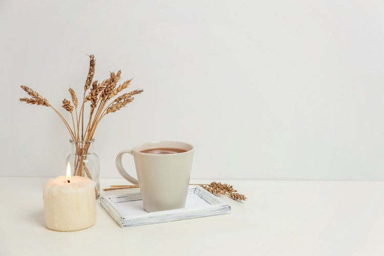 Natural eco home decor with cup coffee and candle on tray example image 1