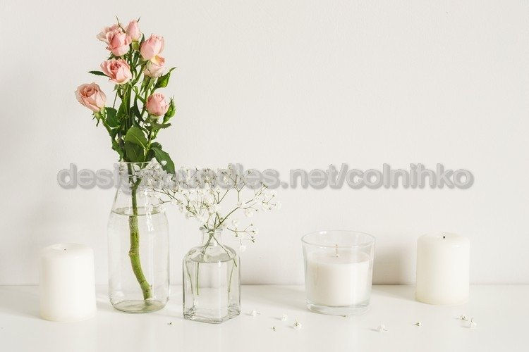 White arrangement of roses and candle