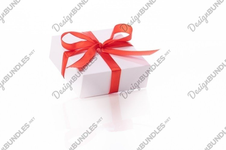 White cardboard gift box tied with red satin ribbon and bow example image 1